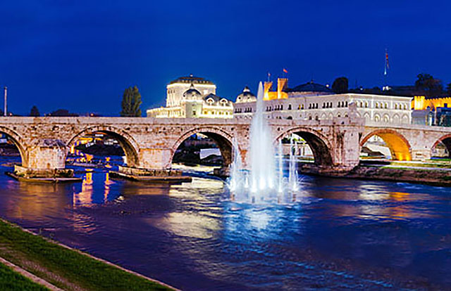 Stone bridge in skopje center, the river vardar, and water fountain in the river