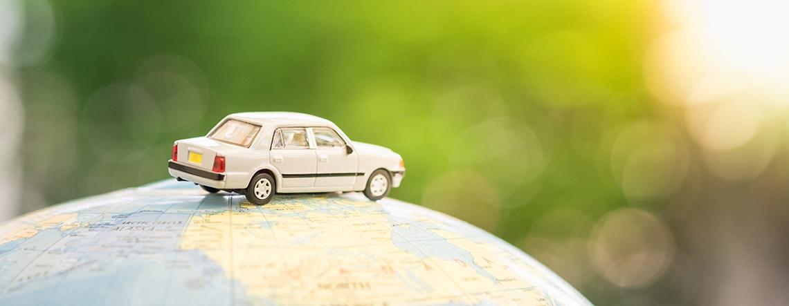 A Hertz rental vehicle on a globe map